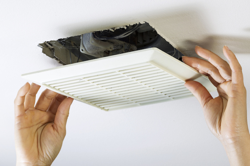 professional checking a bathroom ventilation fan
